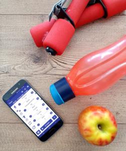 Handy, Zirkeltraining App, Apfel und Flasche